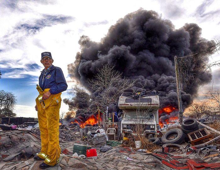 """Pops"" at a trash fire in Primrose. The Photojournalist - 2017 EyeEm Awards Firefighter Burning Everyday Hero Pleasanton VFD Pleasanton Texas"