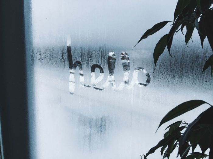 Hello Text On Condensed Glass Window During Monsoon