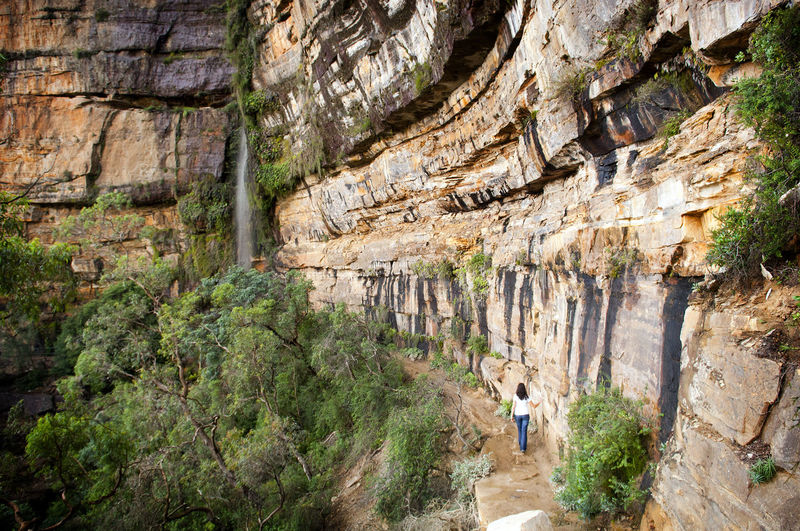 Blue Mountains, Australia near Sydney features deep gorges and rock faces Landscape Australia Australian Blue Blue Mountains Cliffs Female Gorge Katoomba Lithgow Mountains National Pass New South Wales  person Rocks Scenic Tourist Walking Woman Young Rock Solid Rock - Object Rock Formation Nature Mountain Day Travel Geology Travel Destinations Activity Outdoors Group Of People Physical Geography Full Length People Leisure Activity Environment Land Rear View