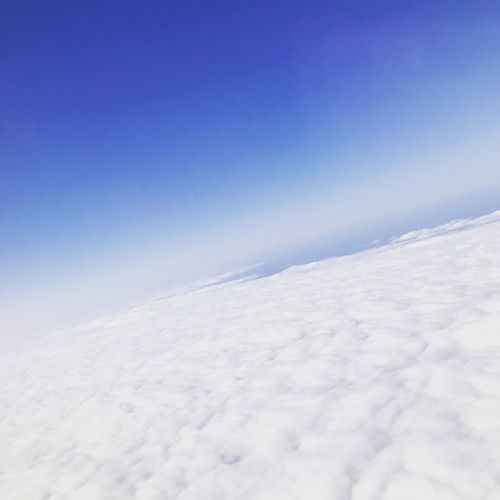 Airplane Fluffy Clouds Cloud View Sky Tranquility Beauty In Nature Cold Temperature White Color Blue Environment Scenics - Nature