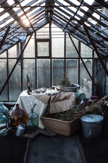 Indoors  Day No People Built Structure Window Greenhouse Table Glass - Material Nature Ceiling Transparent Large Group Of Objects Business Architecture Container Sunlight Building Metal Arrangement