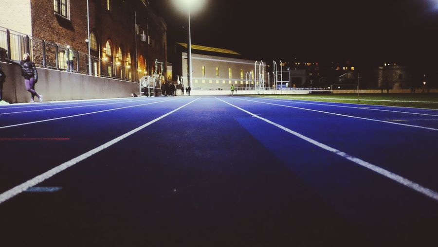Track Attack - sprint practice 💪🏻✨ Illuminated Night Building Exterior Architecture Built Structure The Way Forward Road Real People Outdoors City Sports Track Sky Sport Track Attack Blue Running 🏃🏻 Pushing Limits Lines