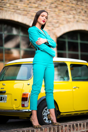 MiniCooper Cars Mode Of Transportation One Person Young Adult Real People Car Young Women Motor Vehicle Lifestyles Women Leisure Activity Yellow Looking Away Hairstyle Fashion Solid Girl Style Style And Fashion Clothes