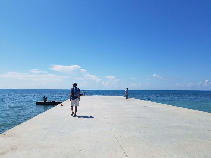 Sea Water Sky Real People Horizon Horizon Over Water Full Length Day Men Two People Scenics - Nature Beauty In Nature Lifestyles Nature Leisure Activity People Adult Land Rear View Outdoors