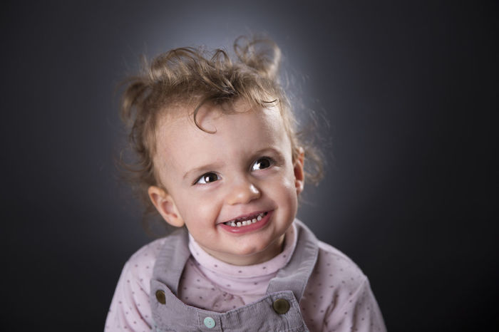 Two years girl laughing Babies Only Baby Blond Hair Childhood Cute Gray Background Happiness Headshot Innocence Looking At Camera Portrait Smiling