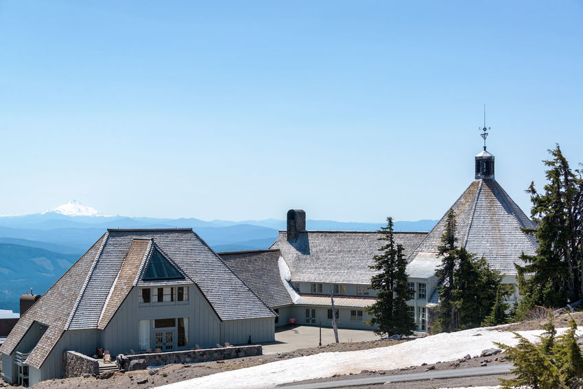 TIMBERLINE LODGE - MAY 8: View of Timberline Lodge in Oregon with Mt. Jefferson in the background on May 8, 2015 Architecture Blue Building Building Exterior Built Structure Clear Sky Day Forest Hotel Lodge Mount Hood Mount Jefferson Mountain Mt Hood Mt Jefferson National Forest No People Oregon Outdoors Pacific Northwest  Sky Snow Timberline Timberline Lodge Tree