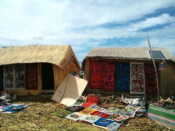 Houses on the Islas De Los Uros, Peru. · Dwellings Architecture Island Life Colors Titicaca Lake Alternative Energy Rural Landscape