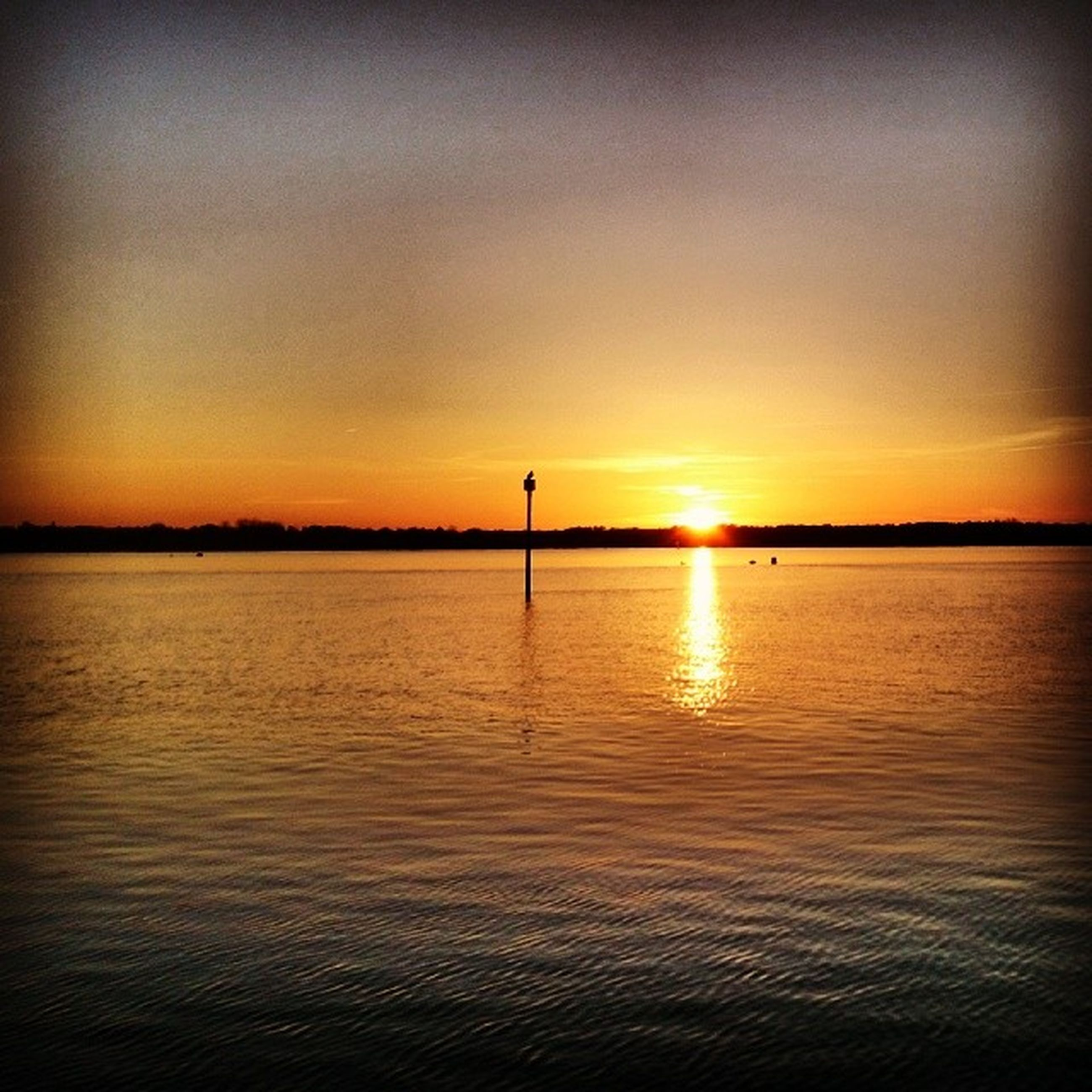 sunset, water, scenics, tranquil scene, tranquility, sun, beauty in nature, orange color, sea, idyllic, reflection, waterfront, rippled, nature, sky, majestic, calm, ocean, distant, dramatic sky, vacations, outdoors, seascape, atmosphere, non-urban scene, vibrant color, romantic sky, remote, atmospheric mood, moody sky