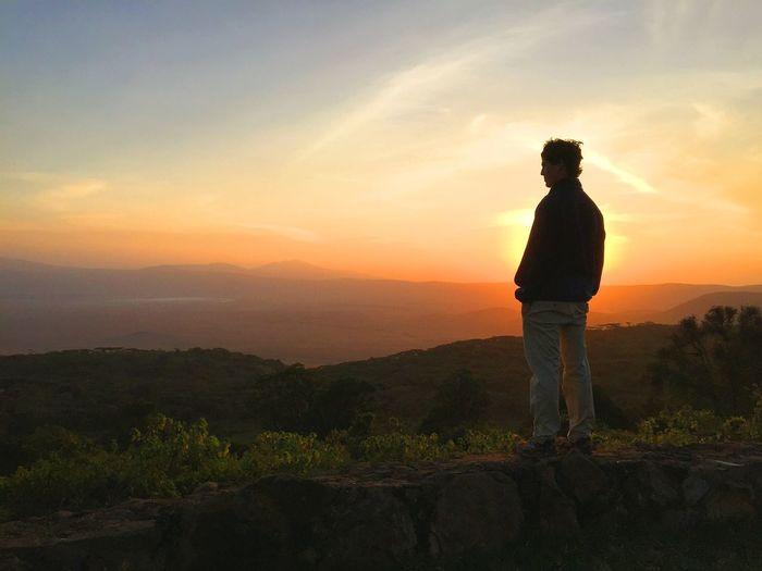 Man looking at sunset
