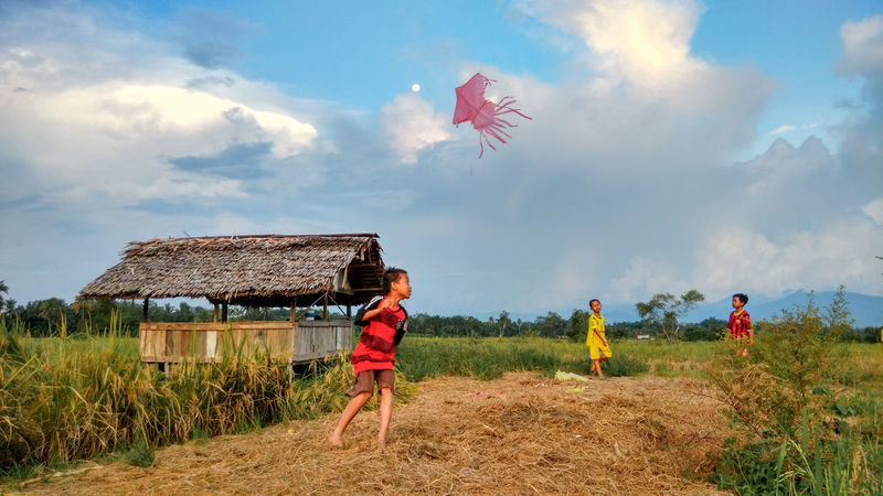 Adult Agriculture Blue Boys Boys Will Be Boys Child Childhood Children Only Cloud - Sky Day EyeEmNewHere Females Flying Full Length Happiness Hut Kite Kite - Toy Nature Outdoors Paddy Field People Rural Scene Sky Togetherness The Secret Spaces The Street Photographer - 2017 EyeEm Awards