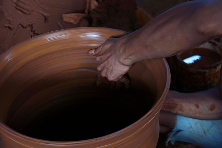 The making of pottery #Amazing #Indonesia #Jogjakarta #lifting #necked Vase #oddly Satisfyin #pulling #skillcrane #Talent #throwing Barrel Clay Close-up Cylinder Day Earthenware Human Body Part Human Hand Indoors  Making Motion One Person People Real People Skill  EyeEmNewHere EyeEm Selects
