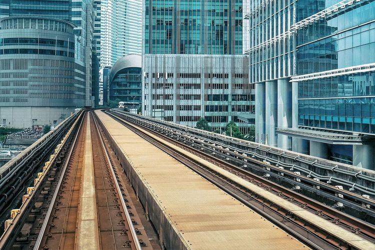 Rail Transportation Architecture Railroad Track Track Building Exterior Built Structure City Transportation Office Building Exterior Building Public Transportation Mode Of Transportation Skyscraper Modern Connection No People Train Day Travel Diminishing Perspective Outdoors The Architect - 2019 EyeEm Awards