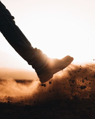 'Kick it' EyeEm EyeEm Selects The Week Of Eyeem Eyeem Market Eyeemphoto EyeEm Gallery EyeEm Best Shots Desert Walking Human Body Part Dust Silhouette Sunlight The Creative - 2018 EyeEm Awards