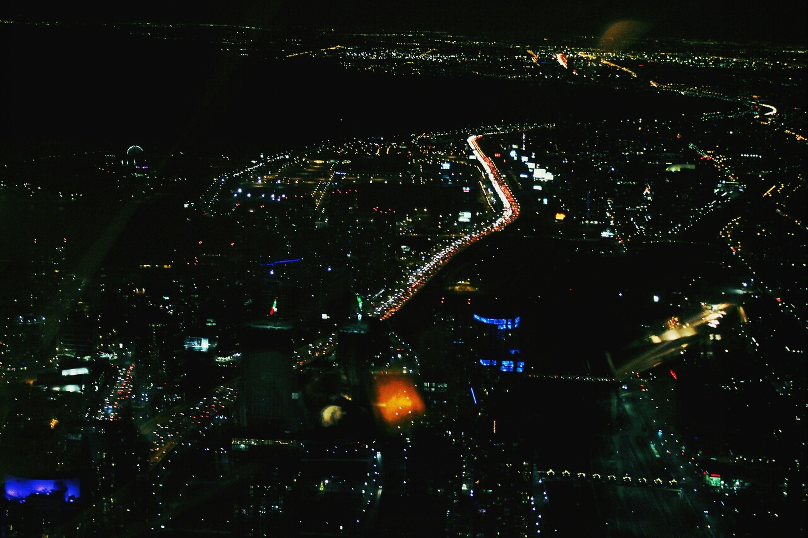 night, illuminated, cityscape, city, aerial view, high angle view, crowded, building exterior, architecture, dark, built structure, light - natural phenomenon, no people, glowing, light, lighting equipment, outdoors, city life, sky, residential district
