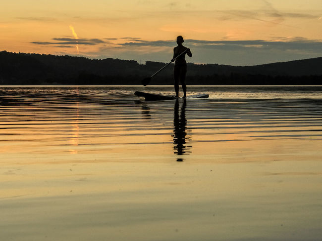 Adult Beauty In Nature Lake Nature One Person Outdoors Reflection See Silhouette Sommer Sommerfeeling Sport Stand Up Paddeln Stand Up Paddle Stand Up Paddle #SUP Stand Up Paddle Boarding Stand Up Paddle Surfing Sundown Sunset Sup Water Woman Young Adult