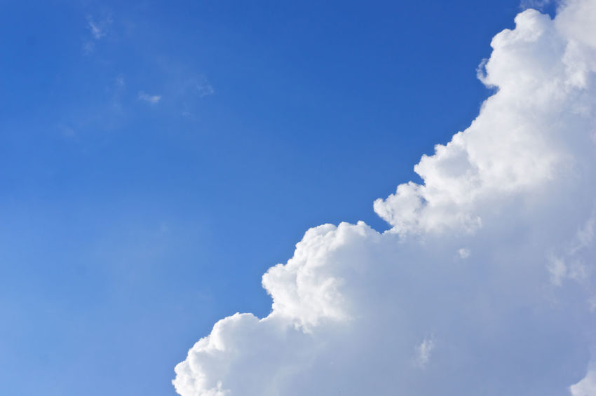 White cloud on right bottom of blue sky as a background. Atmosphere Beautiful Cloud Heaven High Peace Scenic Weather Air Background Blue Climate Cloudscape Cumulus Day Daylight Meteorology Moisture Nature Nebulosity Outdoor Season  Sky Tranquility White