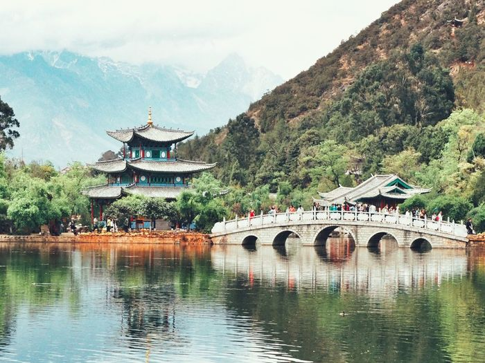 Black dragon pool Black Dragon Pool Yunnan China Lijiang Water Architecture Plant Mountain Tree Built Structure Nature Bridge Travel Destinations Building Exterior Reflection Bridge - Man Made Structure Waterfront