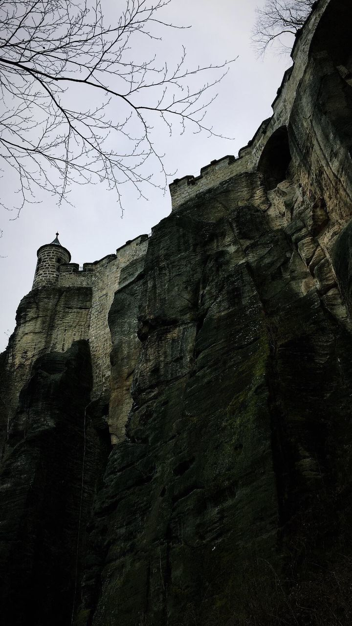 LOW ANGLE VIEW OF CLIFF AGAINST THE SKY
