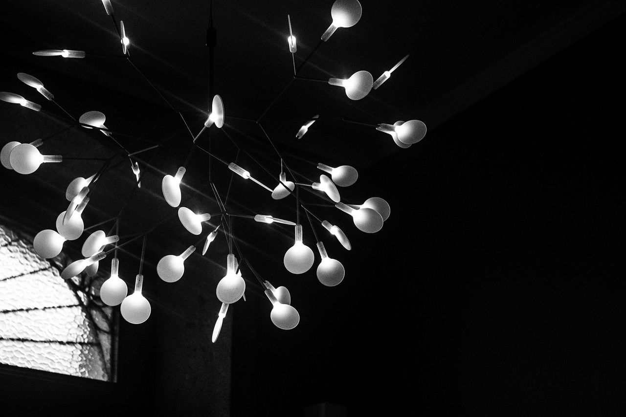 low angle view, no people, illuminated, hanging, black background, studio shot, indoors, night, close-up