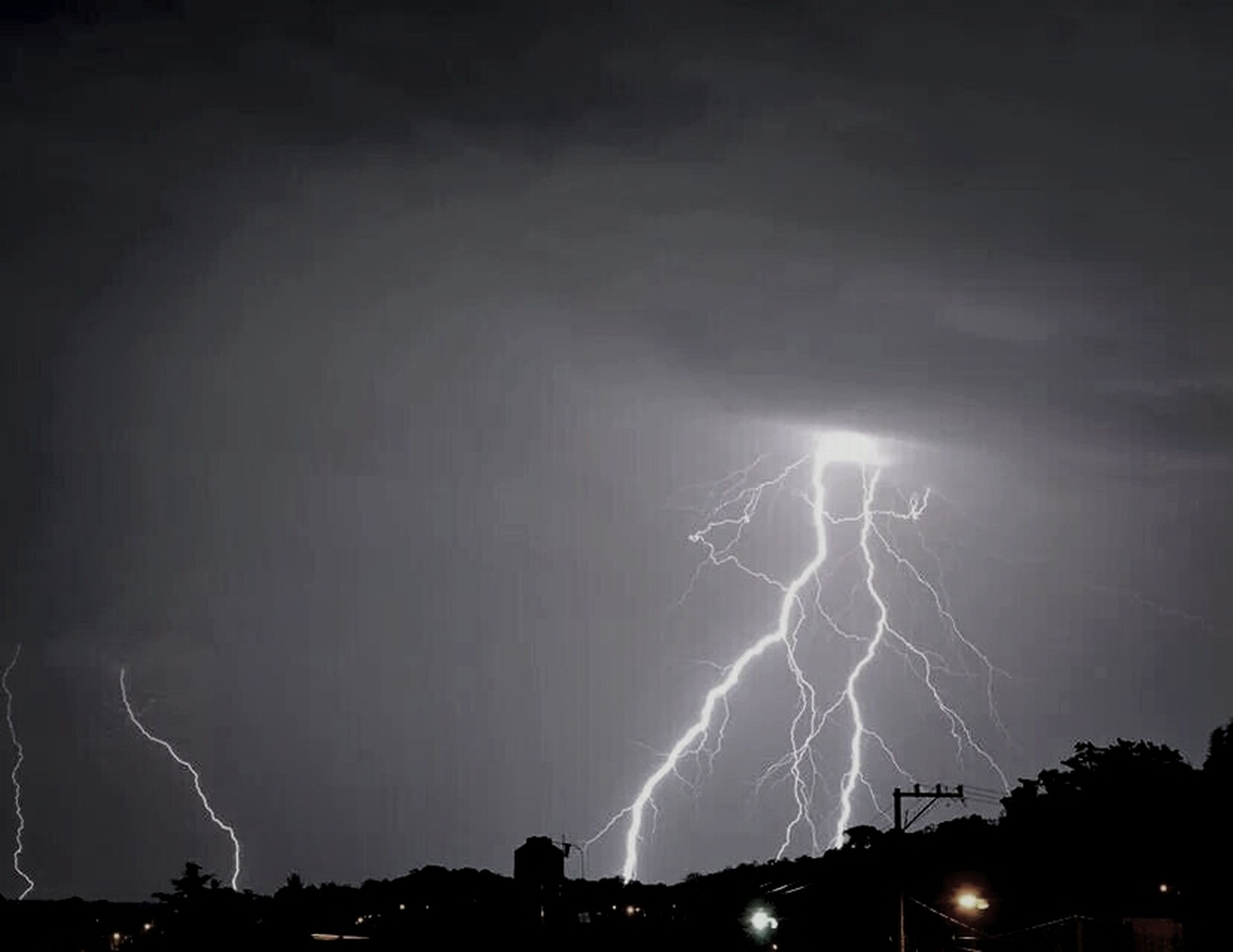 night, illuminated, lightning, sky, thunderstorm, power in nature, low angle view, long exposure, electricity, glowing, forked lightning, storm, light - natural phenomenon, outdoors, motion, no people, nature, weather, light, beauty in nature