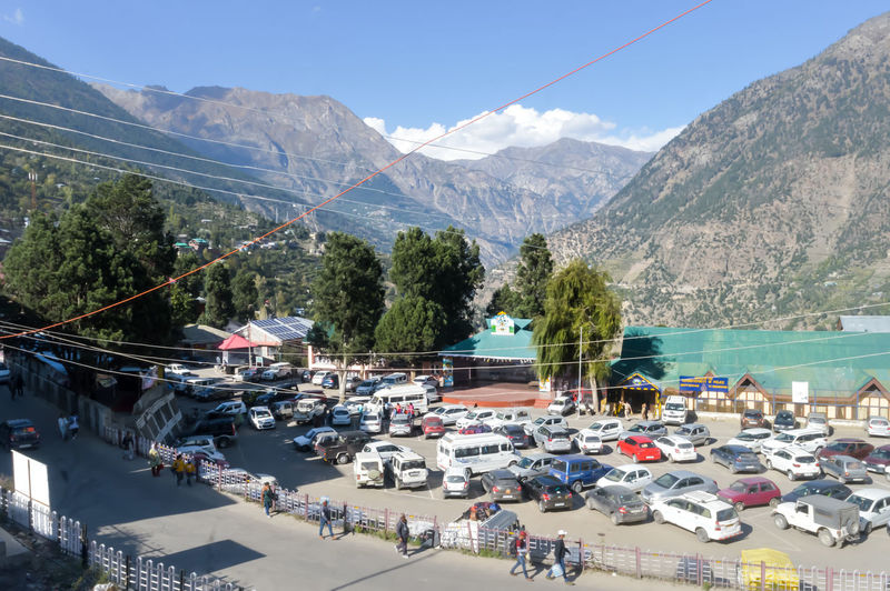 High angle view of cars on road against mountain range