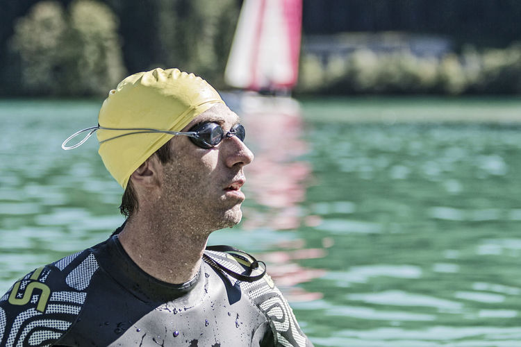 Close-Up Of Man Wearing Swimming Goggles In Sea