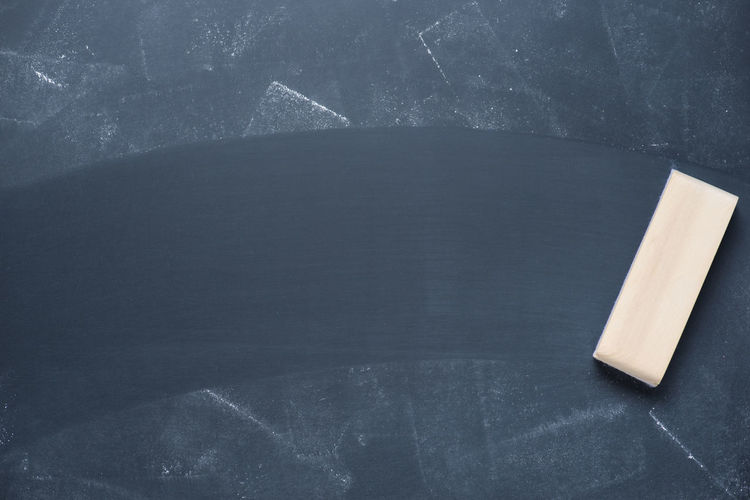 Close-Up Of Duster On Blackboard