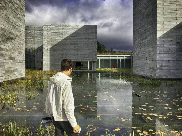 One Person Building Exterior Architecture Cloud - Sky Built Structure Leisure Activity Reflection Contemplation Nature Water PotomacMD Museum Museum Of Modern Art