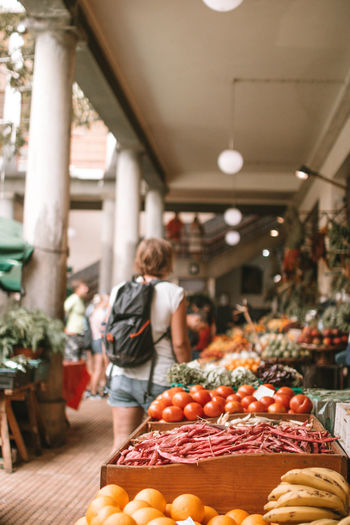 Funchal Adult Day Focus On Foreground Food Food And Drink Freshness Fruit Healthy Eating Incidental People Large Group Of Objects Lifestyles Market Market Stall One Person Orange Real People Retail  Vegetable Wellbeing Women