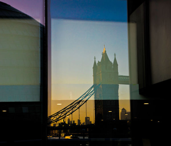 Reflection of tower bridge on glass window