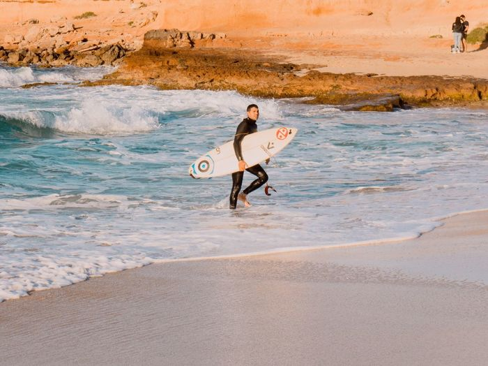 EyeEm Selects Beach Sea Sand Walking Surfboard Surfing Full Length One Man Only Only Men Leisure Activity Wave Nature Outdoors One Person Men Shirtless Adventure Adult Day Vacations Ibiza Beach Cala Conta