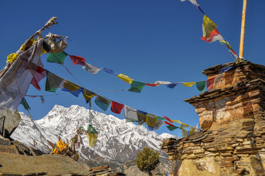Nepal Annapurna Conservation Area Mountain Mountain Range Travel Trekking Colors Circuit Place Of Worship Bunting Flag Streamer Religion Sky Architecture Temple Spirituality Buddhist Temple A New Beginning