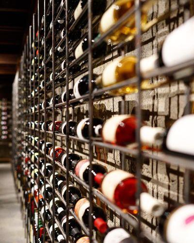 Wine bottles on shelves in cellar