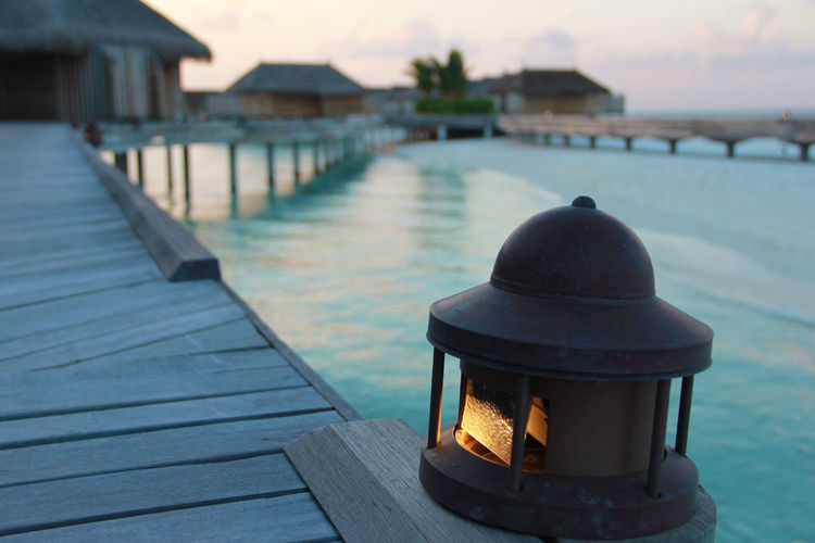 Lantern Outdoor Lamp Sea Deck Wood - Material Wood Deck Night Outdoors Close-up Focus On Foreground Water No People