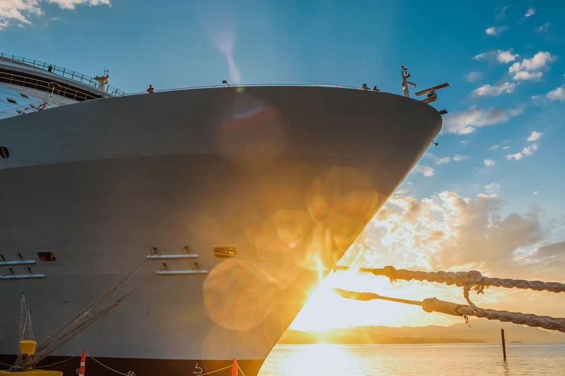 Close view of the cruise ship Sky Nautical Vessel Ship Nature Water Sunset Transportation Mode Of Transportation Cloud - Sky Sunlight Sun No People Lens Flare Outdoors Moored Sunbeam Low Angle View Day Industry Sea Cruise Ship Cruise Boat Sunrays Skyline Travel Destination My Best Photo