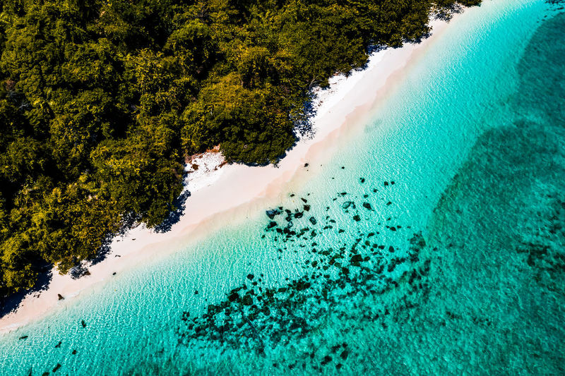 Aerial View of the beach in NyaungOoPhee Island, Myanmar Sea Beach Water Nature Landscape Tree Day Outdoors Forest Tranquility Sand Plant Land Myanmar Top View Beauty In Nature Andaman Green Color High Angle View Tranquil Scene Power In Nature Turquoise Colored Areal View Scenics - Nature NyaungOoPhee Island