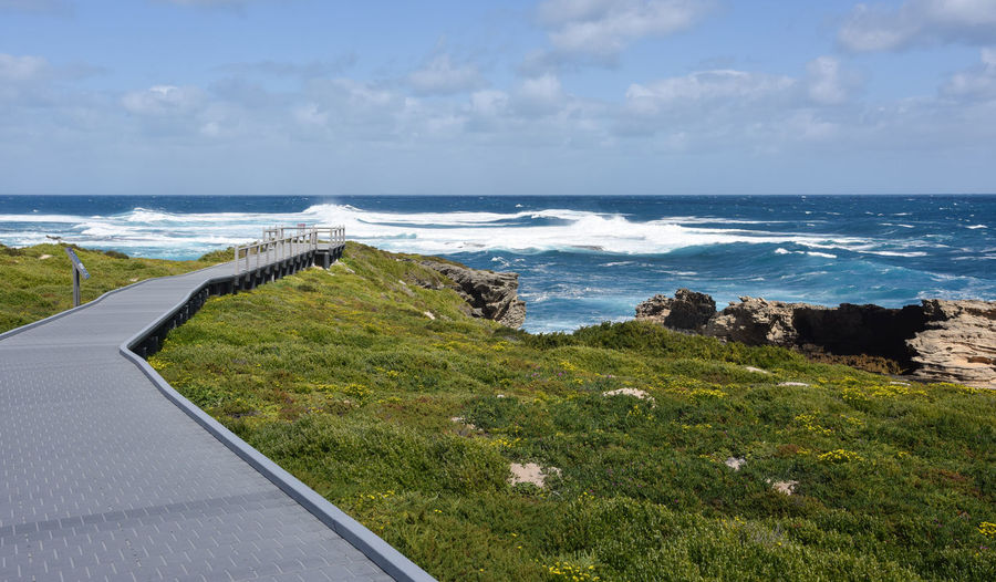 Pathway to the Cape Vlamingh lookout with powerful Indian Ocean waves at Rottnest Island in Western Australia. Australia Beach Cape Vlamingh Coast Dunes Horizon Over Water Indian Ocean Island Landscape Limestone Lookout Nature Observation Point Ocean Ocean View Remote Rock Rottnest Scenics Sea Travel Destinations Walkway Water Wave Western Australia