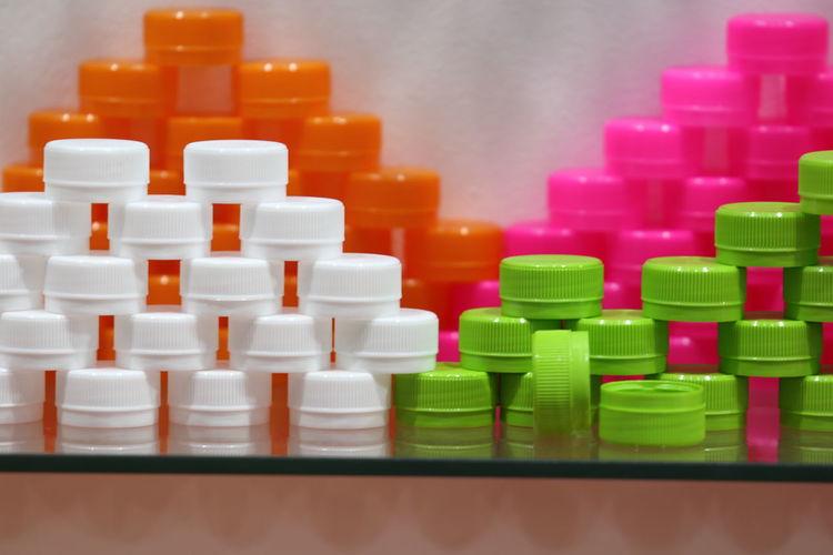 Close-up of bottle caps on shelf