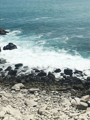 Water Sea Beach Land Wave Motion Beauty In Nature Pebble Outdoors No People Rock - Object Tranquility Scenics - Nature Aquatic Sport Rock Power In Nature Day