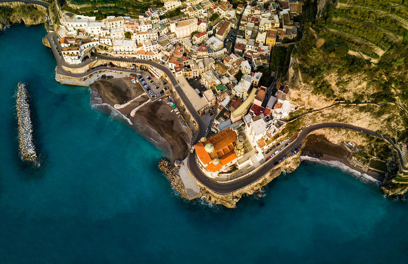 High angle view of cityscape by sea