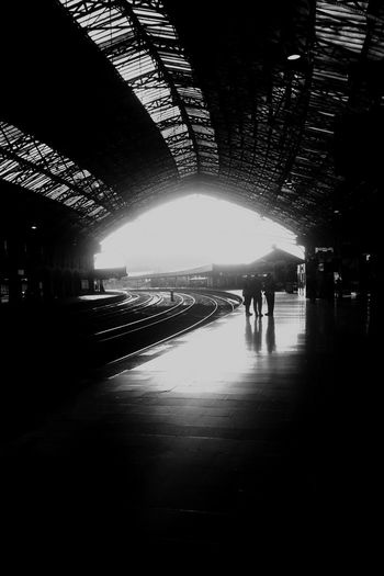 Transportation Railway Station Blackandwhite Black And White Photography Black And White Small Group Of People Victorian Architecture Contrast Atmospheric Mood Conversation Moment Intricate Train Station Sillouette Sillhouette
