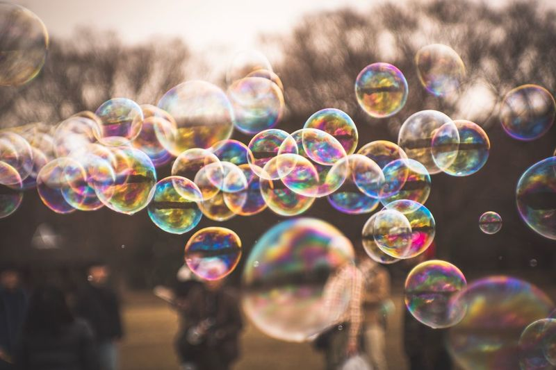 Multi colored bubbles against blurred background