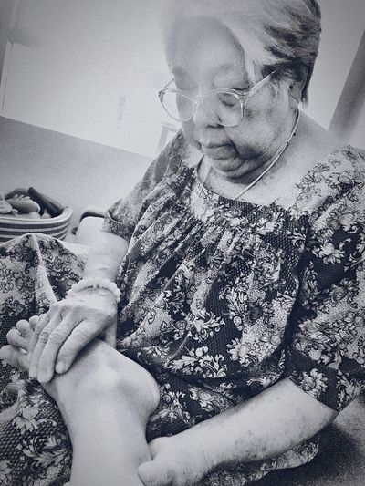 Close-up of woman holding hands at home