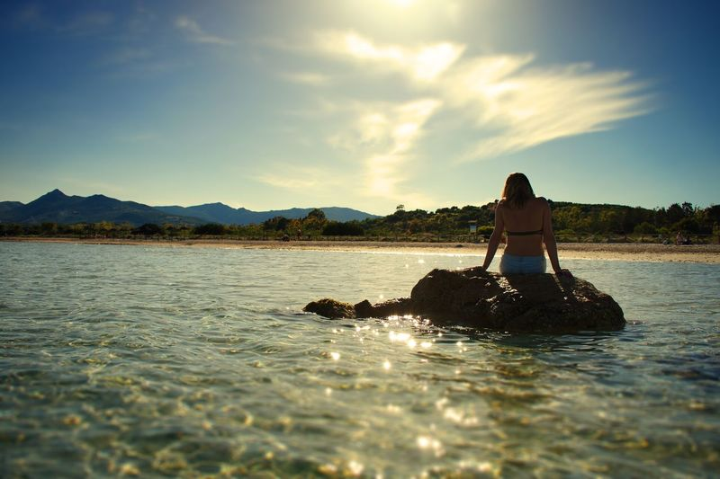 Beach Travel Wanderlust Water Sky Real People Waterfront Nature Lake Lifestyles One Person Beauty In Nature Leisure Activity Day Cloud - Sky Mountain Adult Scenics - Nature Women Sunlight Outdoors