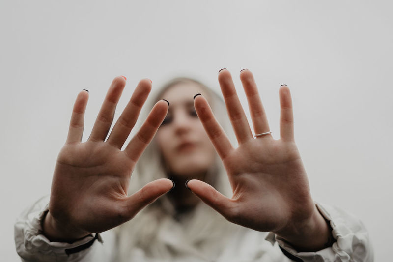 Close-up of person hand over white background
