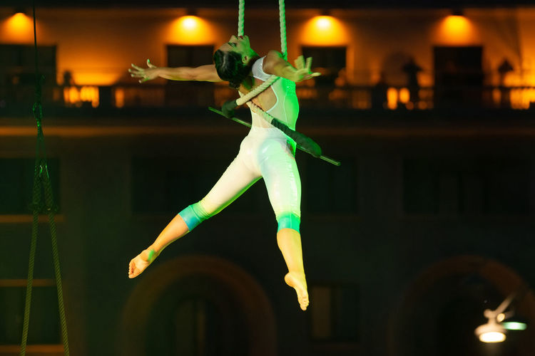 Full length of woman dancing at illuminated nightclub