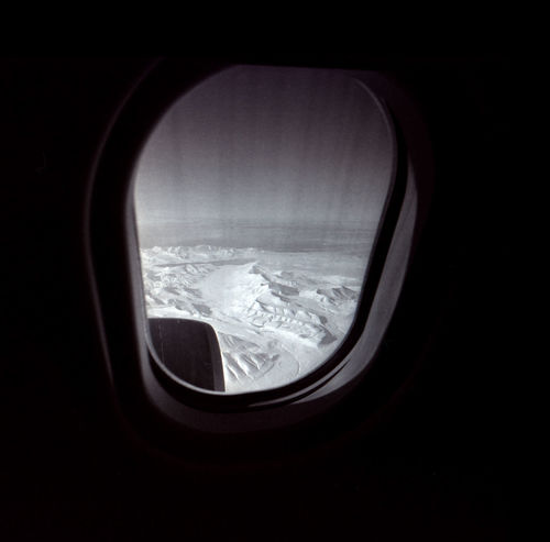 Above the geographical North Pole Adventure Analogue Photography Arctic Climate Change Continent Expedition Film Photography Geographical North Pole Glacier Greenland Ice Cracks Ice Mountains Iron Wings Lomography Nature No People North Pole Outdoors P Plane Window Polar Flight Pole Snow And Ice  Trip Winter