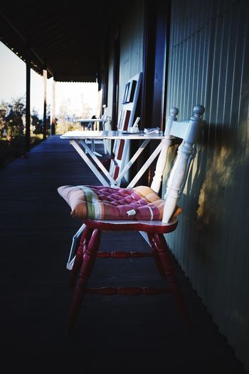 Take a seat EyeEm Selects Seat Architecture Day No People Chair Built Structure Absence Table Wood - Material Empty Window Red The Way Forward Furniture