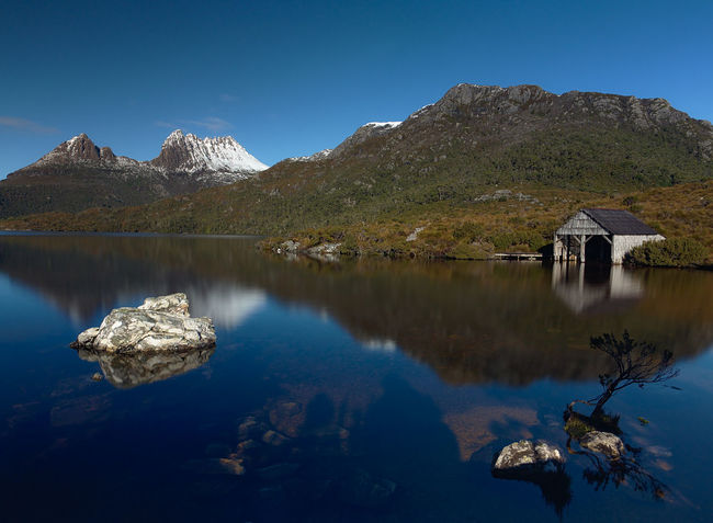A couple of photos from Cradle Mountain while my wife and I were there for our anniversary. It was supposed to be cloudy so we were pleasantly surprised when we woke to a blue sky. Architecture Australian Landscape Beauty In Nature Blue Boatshed Clear Sky Cradle Mountain Cradle Mountain-Lake St Clair National Park Day Dove Lake Eyeem Australia Hiking Lake Mountain Mountain Range Nature No People Outdoors Reflection Sky Tasmania Tranquil Scene Tranquility Tree Water