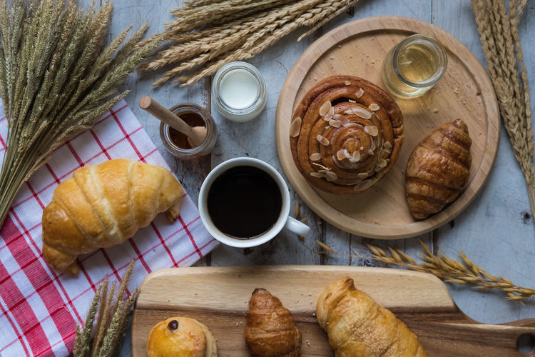 fresh bread and baked goods on wooden chopping board, rustic style Bakery Branch Bread Breakfast Eat Eating Food Landscape Life Meal Morning